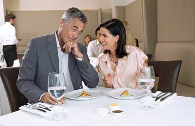 Middle-Aged Couple Talking over Dinner